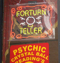 An illuminated sign that reads 'forturn teller'