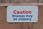 A sign on the harbour wall at Watchet, Somerset, reads 'Slipway may be slippery'.