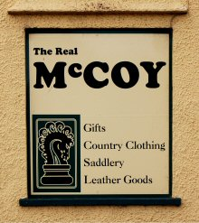 A sign outside McCoy's Saddlery, Porlock, Somerset