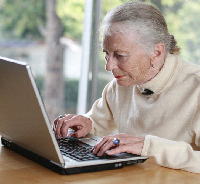 An older person using a computer